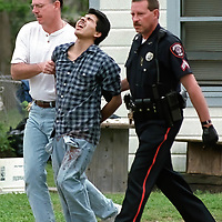 Suspect captured after breaking into a home and hiding.    (Photo by Kim Christensen)