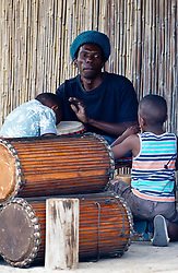 A drummer with an audience on King Langalibalele Street during the Open Streets Langa event on 30 October 2016, when the street was closed to motorised vehicles and opened to people. Hosted by Open Streets Cape Town and supported by the City of Cape town and WWF. photo by John Tee/RealTime Images.