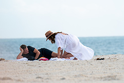 *PREMIUM EXCLUSIVE NO WEB UNTIL 1430 EST JAN 2ND* Cindy Crawford and Rande Gerber are spotted on the beach in Miami on the last day of the decade. The pair who are in town for New Year's Eve are seen in casual workout gear earlier in the day, stopping to say hi to a guy along the path. Then, as they head to lay on the sand Crawford, 53 switches to a white linen cover up while Gerber simply removes his shirt, exposing his chiseled abs, not bad for a 57 year-old. The parents of Kaia Gerber have been in the news of late as reports of their concern over Kaia's choice in men, namely, Pete Davidson, who's built a bit of a reputation for himself in recent years as a troubled young man. Cindy and Rande seem as in love as ever, sharing a bottle of water on the beach before heading up to get ready for tonight's festivities. 31 Dec 2019 Pictured: Cindy Crawford, Rande Gerber. Photo credit: BackGrid/MEGA TheMegaAgency.com +1 888 505 6342