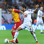 Galatasaray's Selcuk INAN (L) and Eskisehirspor's Alper POTUK (R) during their Turkish Super League soccer match Galatasaray between Eskisehirspor at the TT Arena at Seyrantepe in Istanbul Turkey on Monday, 26 September 2011. Photo by TURKPIX