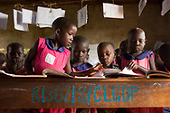 Primary-one students interact with their teacher at Nankandulo Primary School in the Kamuli District of Uganda.