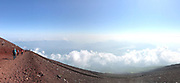 Climbing Mount Fuji, or Fujiyama, above the clouds. It is the tallest mountain in Japan.<br /> Location: Yamanashi, Honshu, Japan