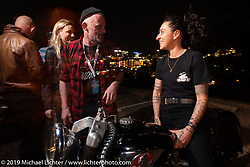 Craig Rodsmith and Madhouse Motors J Shia with her 1957 custom Royal Enfield Indian (Royal Enfield imported and rebadged as Indians after the Springfield factory was closed in 1953) bobber built out of J's Boston shop. The Handbuilt Show pre-party, Austin, TX. Thursday, April 11, 2019. Photography ©2019 Michael Lichter.
