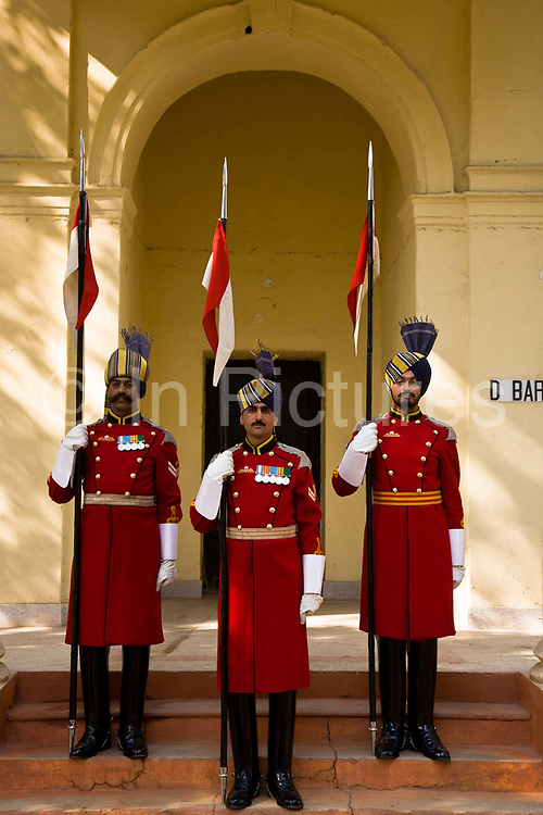 On sentry duty at the Presidential Bodyguard HQ's, three soldiers stand to attention during the short ceremony where different soldiers take up their posts.   The  Presidential Bodyguard or PBG is the Indian Army's preeminent regiment founded in 1773 during the British occupation, this handpicked unit began with a mere 50 men and today stands at 160 soldiers plus 50 support staff. It has a dual role, both as a ceremonial guard for the President of India, with all its finery at important state functions, as well as an elite operational unit for the Indian Army which has seen action in many battle fronts, in particular the on going disputed region of Kashmir, New Delhi, India.