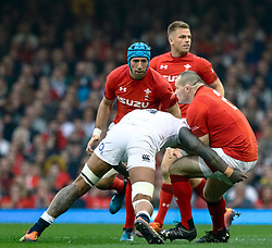 Ken Owens of Wales is tackled by Courtney Lawes of England<br /> <br /> Photographer Simon King/Replay Images<br /> <br /> Six Nations Round 3 - Wales v England - Saturday 23rd February 2019 - Principality Stadium - Cardiff<br /> <br /> World Copyright © Replay Images . All rights reserved. info@replayimages.co.uk - http://replayimages.co.uk