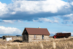 Old log cabin on an old farm in the mountains above Blackfoot Idaho