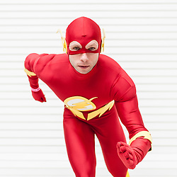 © Licensed to London News Pictures. 20/02/2016. London, UK. A man dressed as The Flash is amongst the fans gathered at the London Super Comic Convention at the Excel Centre in Docklands.  Many have dressed in homemade costumes which have taken hours to make with great attention to detail.<br />  Photo credit : Stephen Chung/LNP
