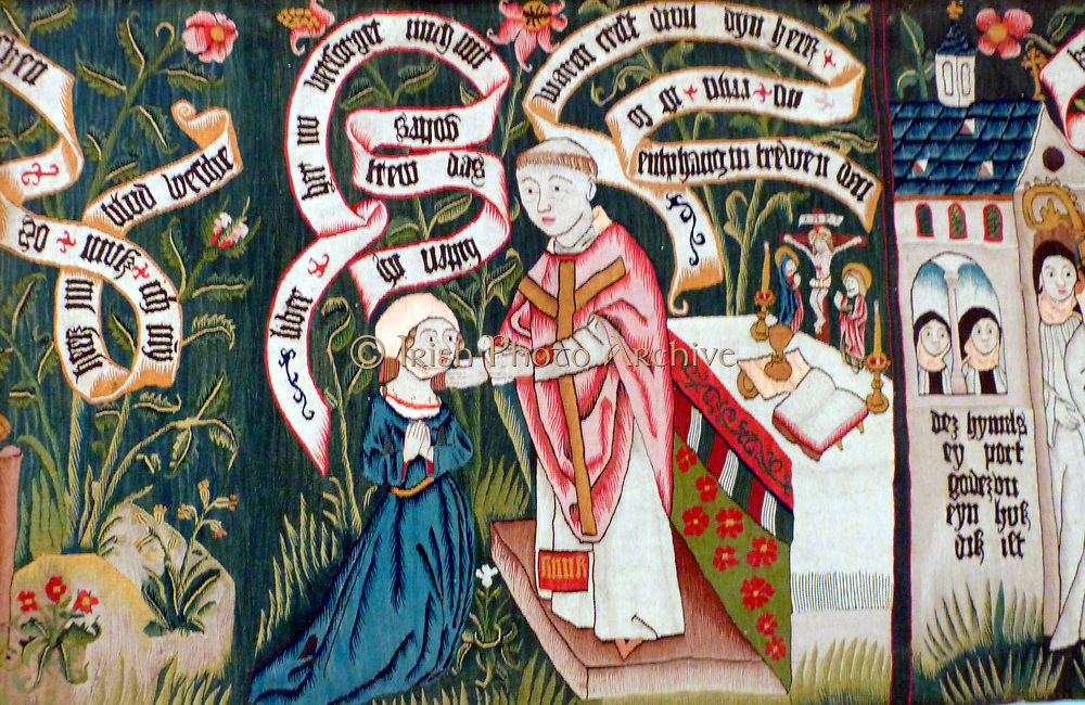 Tapestry about 1490.  This image depicts a woman in fashionable dress undertaking a spiritual journey.  After prayer, confession, washing her heart in Christ's blood to purify it and taking Holy Communion, she finally enters a convent.