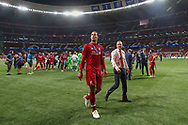 CHAMPIONS Liverpool players and staff celebrate and Liverpool defender Virgil van Dijk (4) looks for his partner in the stands after Liverpool win the UEFA Champions League Final match between Tottenham Hotspur and Liverpool at Wanda Metropolitano Stadium, Madrid, Spain on 1 June 2019.