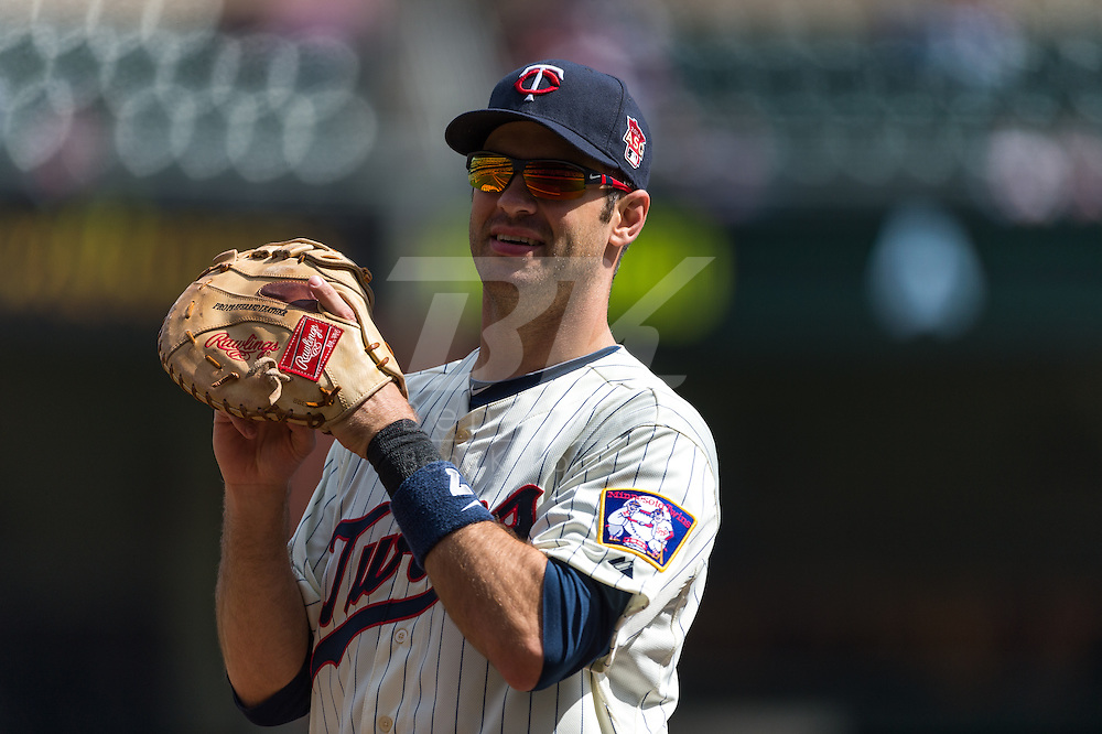 Joe Mauer #7 of the Minnesota Twins during a game against the Oakland Athletics on April 9, 2014 at Target Field in Minneapolis, Minnesota.  The Athletics defeated the Twins 7 to 4.  Photo by Ben Krause