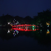 A man exercises early in the morning on the wooden red-painted Huc Bridge, also know as the Morning Sunlight Bridge and The Red Bridge which connects Jade Island to the shore of Hoan Kiem Lake, in the centre of Hanoi, Vietnam, 17th March 2012. Photo Tim Clayton