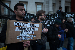 © Licensed to London News Pictures. 28/03/2016. London, UK. A man stands in London's Trafalgar Square as part of a vigil for the victims of the Easter Sunday suicide bombing in a busy public park in Lahore, Pakistan.A faction of the Pakistani Taliban, Jamaat-ul-Ahrar, has claimed responsibility for the attack which killed at least 70 people and wounding more than 300.  Photo credit : Rob Pinney/LNP
