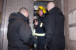 © licensed to London News Pictures. London, UK. 27/01/12. Fire brigade inside building. Protestors cleared from new site in the City of London. The 'Bank of Ideas' group, who had occupied the disused Bank of Iraq building at 7-10 Leadenhall, are cleared after it emerged the building is a diplomatic premises under Section 9 of the 1977 Criminal Law Act. Fire services cleared the street after finding a strong smell of Diesel upon entry to the premises and cleared. Photo credit: Jules Mattsson/LNP