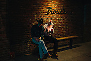 Mel Lawrence, left, takes a break from dancing at Trout's on a Monday night. Trout's is a honky tonk bar in Oildale, a community north of Bakersfield, California. The bar is known for performing acts like Bakersfield natives Merle Haggard and Buck Owens.