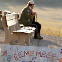 Just after sunrise on September 9, 2005 a vistor to the Temporary Memorial at the crash site of Flight 93 pauses to look out over the field where four years ago the passengers and crew of Flight 93 lost their lives in an  terriorist attack. (UPI Photo/ArchieCarpenter)