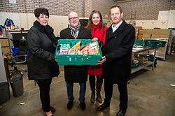 Pictured: Elena Whitham, Kevin Stewart, Aileen Campbell and Jon Sparkes with a typical bundle of donated goods<br /> <br /> Today, Communities Secretary Aileen Campbell was joined by Councillor Elena Whitham, Cosla Community Wellbeing Spokesperson, Kevin Stewart, Minister for Local Government, Housing and Planning and Jon Sparkes Chief Executive of Crisis as she visited Cyrenians' Good Food depot where she met staff at the depot and toured the facility which redistributes surplus food to not-for-profit organisations. <br /> <br /> Ger Harley | EEm 27 November 2018