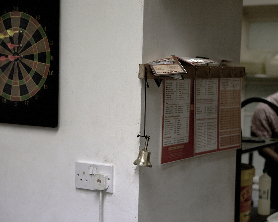 Calling Bell Dartboard in a kitchen at a Indian Takeaway