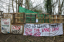 Wendover, UK. 18th March, 2021. A section of the wall of Stop HS2's Wendover Active Resistance Camp in woodland threatened by the HS2 high-speed rail link project. Activists have set up several such camps along the Phase One route of the £106bn rail link between London and Birmingham.