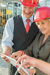 Architect and customer looking at digital tablet
