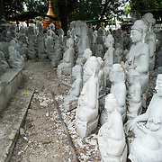 MANDALAY, Myanmar - Local artisans undertake the dusty and backbreaking work of carving statues of the Buddha out of marble. With Buddhism being the dominant religion in Myanmar, there is considerable demand for the statues, with clients able to choose from a myriad of poses, sizes, and styles. The artisans are clustered on a street in the Chanmyathazi neighborhood of Mandalay near the Mahamuni Pagoda.
