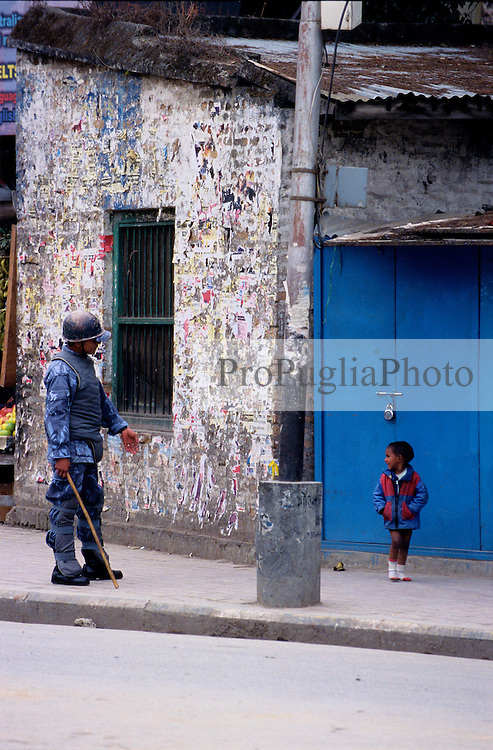 Kathmandu, 18 February 2005. Nation's Democracy Day. A Police officer is trying to keep the road clear from pedestrian