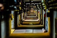 A long hallway inside the gigantic Itaipu Hydroelectric Power Plant, on the border of Brazil and Paraguay.<br /> <br /> In terms of power output, Itaipú Dam is one of the world's largest hydroelectric projects. Its 20 massive turbine generators, located in the powerhouse at the base of the dam, are capable of generating 14,000 megawatts of electricity.