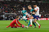 Florian Muller of Germany U21's grabs the ball to deny Doninic Solanke of England U21's a chance of scoring a goal during the U21 International match between England and Germany at the Vitality Stadium, Bournemouth, England on 26 March 2019.