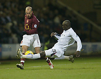 Photo: Aidan Ellis.<br /> Bolton Wanderers v Arsenal. The Barclays Premiership.<br /> 03/12/2005.<br /> Bolton's Abdoulaye Faye tackles Arsenal's Freddie Ljunberg