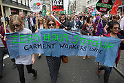 London, UK. Saturday 20th June 2015. People's Assembly against austerity demonstration through Central London. 250,000 people gathered to protest in a march through the capital protesting against the Tory cuts, holding placards and banners including this Zero hours contracts one.