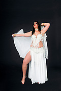 Belly dancer in white On black Background