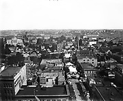 9210-01. Portland bird's-eye view from the old Oregonian Building, at corner of Sixth and Washington SW. c. 1898-1900. Taken looking north on Sixth street, which is partially blocked with tents.  The spire is Trinity Episcopal Church at 6th & Oak.  The Imperial is 7th (Broadway) and Washington. Sneil is on 6th between Ankeny and Burnside