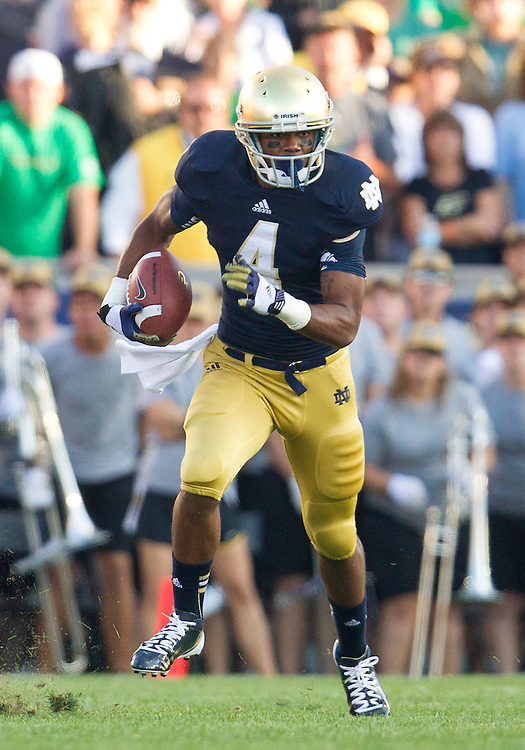 September 08, 2012:  Notre Dame running back George Atkinson III (4) runs for yardage on kick return during NCAA Football game action between the Notre Dame Fighting Irish and the Purdue Boilermakers at Notre Dame Stadium in South Bend, Indiana.  Notre Dame defeated Purdue 20-17.