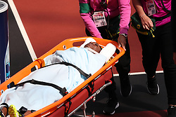 Trinidad and Tobago's Deborah John is removed from the track on a stretcher after a fall during the Women's 100m hurdles heats during day eight of the 2017 IAAF World Championships at the London Stadium.