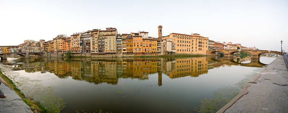 Residential buildings on the banks of the River Arno, with the Ponte Vecchio at extreme left, Florence (Firenze) in the early morning light. High resolution panorama.
