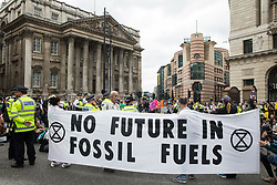 Extinction Rebellion climate activists block roads in front of the Bank of England on the eleventh day of their Impossible Rebellion protests on 2nd September 2021 in London, United Kingdom. The activists, who had marched from the Tate Modern, included over fifty wearing signs indicating that they were breaking restrictive bail conditions by entering the City of London. Extinction Rebellion are calling on the UK government to cease all new fossil fuel investment with immediate effect.