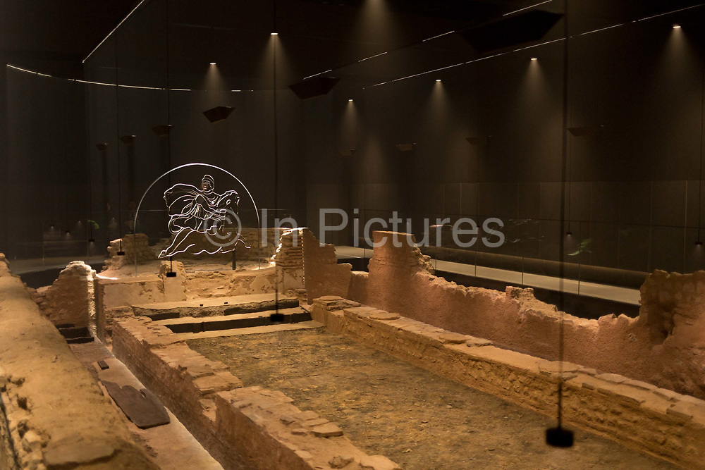 Atmospheric lighting helps display the reconstructed mid-3rd century Roman Mithraeum also known as the Temple of Mithras, Walbrook where bull-sacrifice was practised, now beneath Bloombergs new European headquarters and open to the public, on 26th November 2017, in the City of London, England.