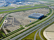 Nederland, Noord-Holland, Schiphol; 23-03-2020; Vliegtuigen blijven op de grond op Schiphol. Het aantal passagiers is met meer dan 60 procent gedaald  ten gevolge van de Corona-crisis. Terreinen voor lang parkeren zijn nagenoeg leeg. Aircraft remain on the ground at Schiphol. Passenger numbers have fallen by more than 60 percent as a result of the Corona crisis. There are substantially fewer flights, parkings are empty.<br /> luchtfoto (toeslag op standaard tarieven);<br /> aerial photo (additional fee required)<br /> copyright © 2020 foto/photo Siebe Swart