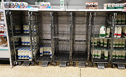 © Licensed to London News Pictures. 27/08/2021. London, UK. Nearly empty shelves of fresh milk in Sainsbury's, north London. UK food producers and supermarkets are warning that empty shelves could continue unless the government acts to resolve the shortage of workers and lorry drivers, caused by Brexit and the coronavirus pandemic. Photo credit: Dinendra Haria/LNP