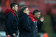 Swansea city assistant coaches Joao Mario (right) and Bruno Lage (l) stand on the touchline alongside Swansea city manager Carlos Carvalhal  © during the Premier league match, Swansea city v Tottenham Hotspur at the Liberty Stadium in Swansea, South Wales on Tuesday 2nd January 2018. <br /> pic by  Andrew Orchard, Andrew Orchard sports photography.