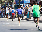 22/11/2015  repro fee.  A group of 25 from Gorta-Self Help Africa travelled to the capital of Ethiopia Addis Ababa for the great Ethiopian run which is Ethiopia's Haile Gebrselassie last race seen here running bare foot for the last KM  .  In temperatures in the mid 30 degree heat and 40,000 people and a city at 7,500 feet above sea level, it's no mean feat.   Photo:Andrew Downes <br /> <br /> <br /> Pics to be used with Gorta - Self Help Arica images only
