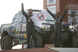 LIMA, Jan. 7, 2019  Chinese driver Liang Yuxiang (R) and co-driver Kou Hongtao of Yong Racing team pose on the podium during the departure ceremony at the 2019 Dakar Rally Race, Lima, Peru, on Jan. 6, 2019. The 41st edition of Dakar Rally Race kicked off in Lima, Peru. (Credit Image: © Xinhua via ZUMA Wire)