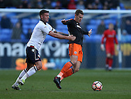Gary Madine of Bolton holds Paul Coutts of Sheffield Utd during the FA Cup Second round match at the Macron Stadium, Bolton. Picture date: December 4th, 2016. Pic Simon Bellis/Sportimage