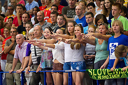 Fans of Slovenia during basketball match between National teams of Slovenia and Spain in Qualifying Round of U20 Men European Championship Slovenia 2012, on July 18, 2012 in Domzale, Slovenia. Slovenia defeated Spain 70-63. (Photo by Vid Ponikvar / Sportida.com)