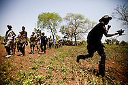 Jie elders dance during a ritual as the community struggles to face increasing cattle raids from the Taposa in the south, continuing child abductions, and the need to avenge the murder of community member Jonglei state, Southern Sudan.