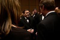 """20 NOV 2003, NEW YORK/USA:<br /> Gerhard Schroeder, SPD, Bundeskanzler, im Gespraech mit Spitzenvertretern der Wirtschaft, waehrend einem Empfang vor einer Festveranstaltung des American Institute for Contemporary German Studies anl. der Verleihung des """"Global Leadership Awards"""" Hotel Grand Hyatt at Grand Central<br /> IMAGE: 20031120-03-009<br /> KEYWORDS: Gerhard Schröder, U.S.A., Reise, Smoking<br /> Gespräch"""