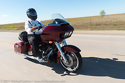 Jim Entenman of J and L Harley-Davidson in Sioux Falls riding on the USS South Dakota submarine flag relay across South Dakota on the first day from Sturgis to Aberdeen. SD. USA. Saturday October 7, 2017. Photography ©2017 Michael Lichter.