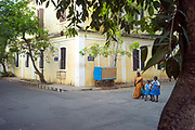 A woman and her two daughters in school uniform cross the street in the old French part of Pondicherry en route to school, India. Pondicherry now Puducherry is a Union Territory of India and was a French territory until 1954 legally on 16 August 1962. The French Quarter of the town retains a strong French influence in terms of architecture and culture.