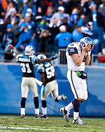 CHARLOTTE, NC - DECEMBER 16:   Matt Hasselbeck #8 of the Seattle Seahawks reacts after a fumble at the end of the game against the Carolina Panthers at Bank of America Stadium on December 16, 2007 in Charlotte, North Carolina.  The Panthers defeated the Seahawks 13-10.  (Photo by Wesley Hitt/Getty Images) *** Local Caption *** Matt Hasselbeck. Sports photography by Wesley Hitt photography with images from the NFL, NCAA and Arkansas Razorbacks.  Hitt photography in based in Fayetteville, Arkansas where he shoots Commercial Photography, Editorial Photography, Advertising Photography, Stock Photography and People Photography