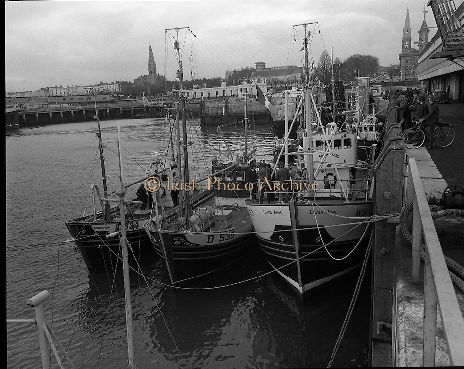New Fishing Vessels at Dun Laoghaire..1971..26.03.1971..03.26.1971..26th March 1971..After display at the World Fishing Exhibition,three fishing vessels valued at £200,000 were handed over to their respective skippers at Dun Laoghaire harbour. The vessels were built by B.I.M.(Bord Iascaigh Mhara) and represent a cross section of the range of boats built in B.I.M. yards..Photograph of the three new vessels moored in Dun Laoghaire. The vessels are named (L-R) Silver Fern, Golden Sunset and Eilish Anne.
