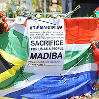 CAPE TOWN, SOUTH AFRICA - Saturday 7 December 2013, a message attached to a South African flag  during a time of national mourning the death of the first democratically elected president, Nelson Mandela, in front of the Cape Town City Hall.<br /> Photo by Roger Sedres/ImageSA